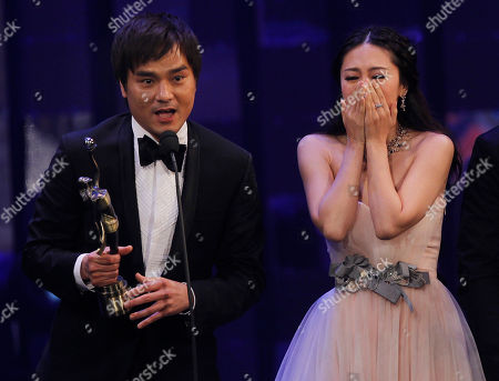 JJ Jia, Gordon Lam Hong Kong actress JJ Jia, right, and producer Gordon Lam celebrates with the trophy after winning the Best Film award for the movie 'Gallants' at the Hong Kong Film Awards in Hong Kong