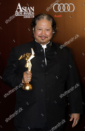 """Sammo Hung Kam-po Hong Kong actor-director Sammo Hung Kam-po poses with the trophy after winning the best supporting actor of his movie """"Ip Man 2"""" at the Asian Film Awards in Hong Kong"""