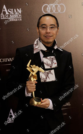 "Apichatpong Weerasethakul Thailand director Apichatpong Weerasethakul poses with the trophy after winning the best film category for his movie ""Uncle Boonmee Who Can Recall His Past Lives"" for the Asian Film Awards in Hong Kong"