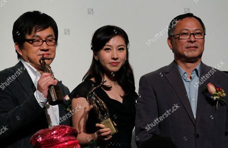 Su Chao-bin, Jia Xiaochen, Johnny To From left, Taiwan director Su Chao-bin, Chinese actress Jia Xiaochen and Hong Kong director Johnny To poses during the Hong Kong Film Critics Society Awards presentation in Hong Kong