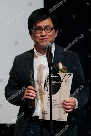 """Stock Photo of Su Chao-bin Taiwan director Su Chao-bin speaks after he received the Best Director award in the movie """"Reign of Assassins"""" during the Hong Kong Film Critics Society Awards presentation in Hong Kong"""
