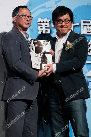 "Stock Photo of Su Chao-bin, Johnny To Taiwan director Su Chao-bin, right, receives the Best Director award in the movie ""Reign of Assassins"" from Hong Kong director Johnny To during the Hong Kong Film Critics Society Awards presentation in Hong Kong"
