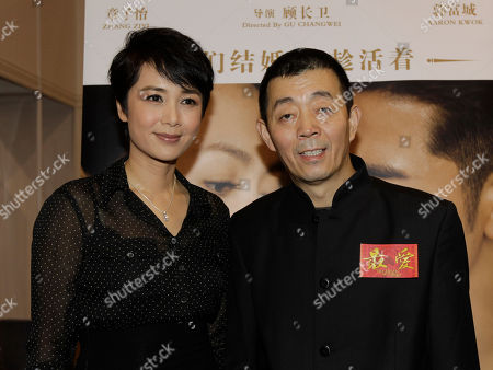 """Gu Changwei, Jiang Wenli Chinese director Gu Changwei, right, and his wife Chinese actress Jiang Wenli attend a promotional event of their latest movie """"Till Death Do Us Part"""" in Hong Kong, as part of the events in Hong Kong International Film Festival"""
