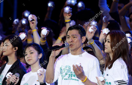 """Stock Photo of Charlene Choi, G.E.M., Andy Lau and Kay Tse From left, Hong Kong singers Charlene Choi, G.E.M., Andy Lau and Kay Tse perform during the charity concert """"Artistes 311 Love Beyond Borders"""" in Hong Kong . Hong Kong entertainment industry stage a concert to raise funds for victims of Japan's massive earthquake and tsunami"""