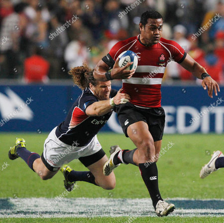 Pohiva Lotoahea, Todd Clever Pohiva Lotoahea of Japan, right, is tackled by Todd Clever of the United State during their match on the first day of the Hong Kong Sevens rugby tournament in Hong Kong