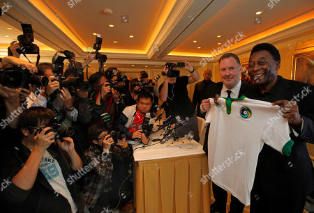Pele Brazilian soccer great poses with Paul Kemsley, second right, chairman of the New York Cosmos, during a press conference in Hong Kong. Pele was in here to promote the rebirth of the Cosmos, hoping for the team to begin play in 2014