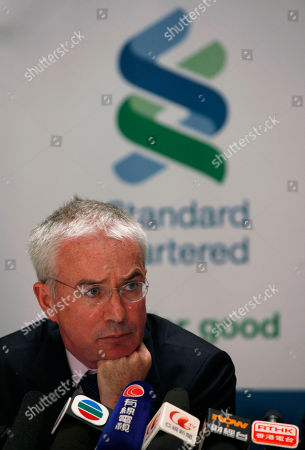 Peter Sands Chief Executive of Standard Chartered PLC Peter Sands speaks during a news conference in Hong Kong . Standard Chartered bank has reported a record profit for the eighth straight year largely on the back of the bank's operations in Hong Kong and India