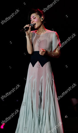 Faye Wong Chinese singer and actress Faye Wong performs at her concert in Hong Kong as part of her Asia tour . Wong will hold her concerts in Hong Kong from March 4 to 6