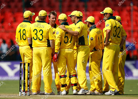 Brett Lee Australia's cricketer Brett Lee, without cap in back, celebrates the dismissal of Canada's John Davison, not seen, with fellow team members during the Cricket World Cup Group A match between Australia and Canada in Bangalore, India
