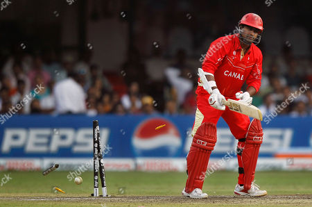Canada's Balaji Rao is bowled during a Cricket World Cup match between Australia and Canada in Bangalore, India