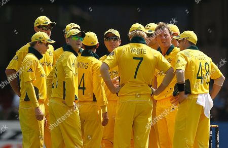 Stock Picture of Australia's Brett Lee, second from right, looks at the television screen to see the replay as he takes the wicket of Canada's John Davison during a Cricket World Cup match between Australia and Canada in Bangalore, India