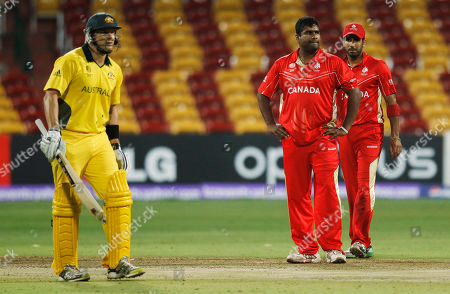 Stock Picture of Canada's Balaji Rao, center, and fellow team member Zubin Surkari, right, react as a catch off Australia's Shane Watson is not taken by a fielder during a Cricket World Cup match between Australia and Canada in Bangalore, India