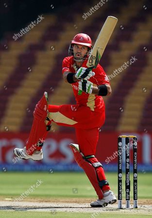 Canada's John Davison plays a shot during a Cricket World Cup match between Australia and Canada in Bangalore, India