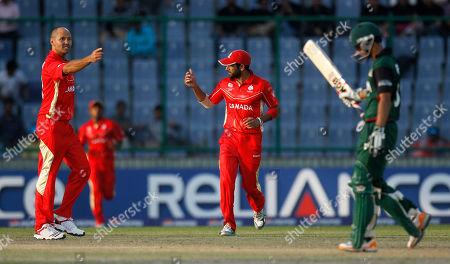 Canada's John Davison, left, reacts after claiming the wicket of Kenya's Tamnay Mishra, right, during a world cup cricket match in New Delhi, India