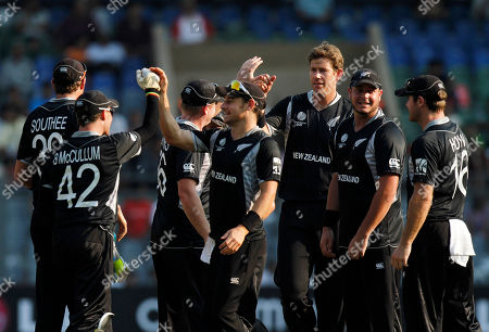 The New Zealand team celebrates the dismissal of Canada batsman John Davison after he was run out by Brendon McCullum, left, on a ball delivered by Jacob Oram, third right, during the World Cup Cricket Group A match between New Zealand and Canada in Mumbai, India