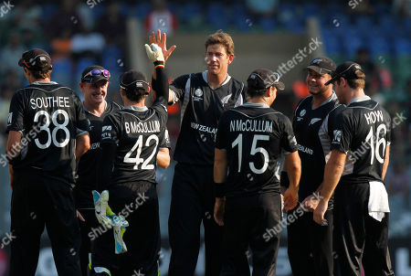 New Zealand team celebrates the dismissal of Canada batsman John Davison after he was run out by Brendon McCullum, third left, on a ball delivered by Jacob Oram, center, during in the World Cup Cricket Group A match between New Zealand and Canada in Mumbai, India