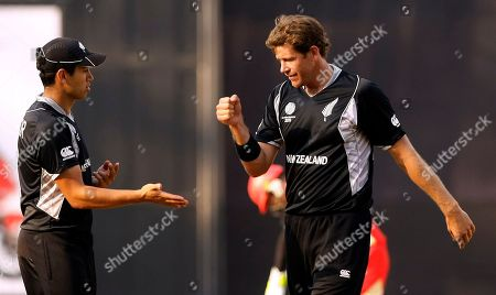 Jacob Oram and Ross Taylor New Zealand's Jacob Oram, right, and Ross Taylor celebrate after the wicket of Canada's Balaji Rao during their Cricket World Cup match against Canada in Mumbai, India