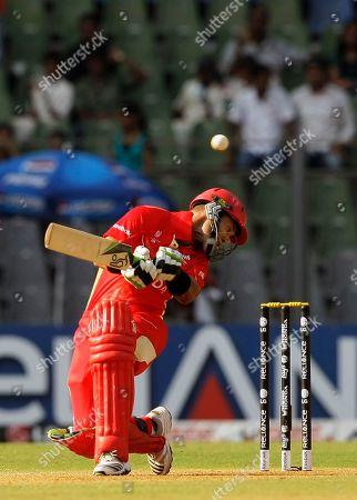 John Davison Canada's John Davison ducks the ball during their Cricket World Cup match against New Zealand in Mumbai, India