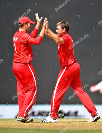 Ray Price, Brendan Taylor Zimbabwe's Ray Price, right, celebrates with teammate Brendan Taylor the dismissal of Canada's John Davison, not seen, during their Cricket World Cup Group A match in Nagpur, India