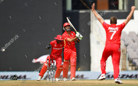 Ray Price, John Davison Zimbabwe's Ray Price, right, celebrates bowling out Canada's John Davison, center, during their Cricket World Cup Group A match in Nagpur, India