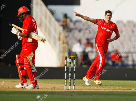 Graeme Cremer, Balaji Rao Zimbabwe's Graeme Cremer, right, celebrates the dismissal of Canada's last wicket Balaji Rao, left, in their Cricket World Cup Group A match in Nagpur, India, . Zimbabwe won by 175 runs