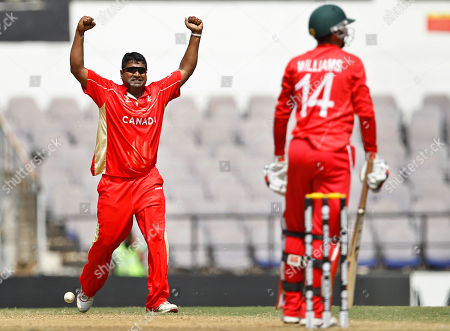 Balaji Rao, Sean Williams Canada's cricketer Balaji Rao, left, celebrates the dismissal of Zimbabwe's Sean Williams, right, during their Cricket World Cup Group A match in Nagpur, India