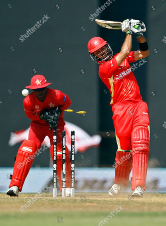 John Davison Canada's John Davison, right, is bowled out by Zimbabwe's Ray Price, not seen, during their Cricket World Cup Group A match in Nagpur, India