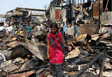 "Rubina Ali Slumdog Millionaire"" child star Rubina Ali walks on the debris at a slum in Mumbai, India, . Ali said Saturday that her home had burned down in a fire that raged through a crowded slum in the Indian city of Mumbai"