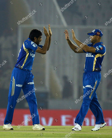 Stock Photo of Munaf Patel, left, and Andrew Symonds of Mumbai Indians celebrate after Patel claimed the wicket of Kings XI Punjab's Paul Valthaty during an Indian Premier League cricket match between Kings XI Punjab and Mumbai Indians in Chandigarh, India