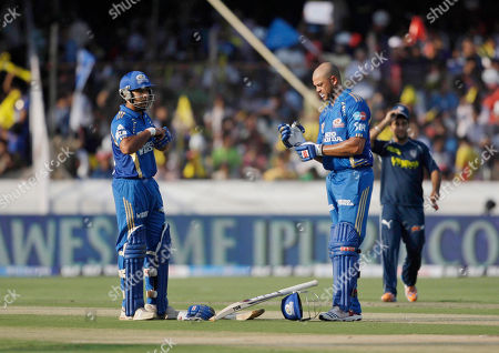 Rohit Sharma, Andrew Symonds Mumbai Indians batsmen Rohit Sharma, left, and Andrew Symonds adjust their gloves during an Indian Premier League (IPL) cricket match against Deccan Charges in Hyderabad, India