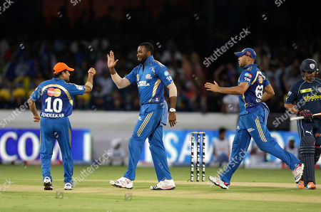 Sachin Tendulkar, Kieron Pollard, Andrew Symonds, Bharat Chipli Mumbai Indians bowler Kieron Pollard, center, celebrates with captain Sachin Tendulkar, left, the wicket of Bharat Chipli, extreme right, as Andrew Symonds joins during an Indian Premier League (IPL) cricket match between Indians and Deccan Chargers in Hyderabad, India