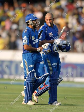 Rohit Sharma, Andrew Symonds Mumbai Indians batsmen Rohit Sharma, left, and Andrew Symonds walk towards the pavilion after their innings during an Indian Premier League (IPL) cricket match against Deccan Chargers in Hyderabad, India