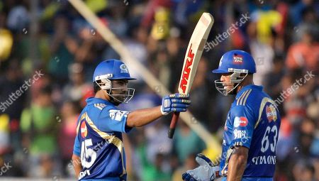 Rohit Sharma, Andrew Symonds Mumbai Indians batsman Rohit Sharma, left, acknowledges his fifty as teamate Andrew Symonds looks on during an Indian Premier League (IPL) cricket match against Deccan Chargers in Hyderabad, India