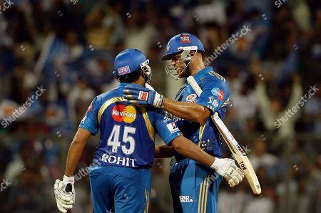 Rohit Sharma, ndrew Symonds Mumbai Indians' Andrew Symonds, right, and Rohit Sharma celebrate after they won the Indian Premier League (IPL) cricket match against Pune Warriors in Mumbai, India