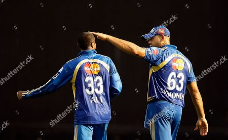 Andrew Symonds, Ali Murtaza Mumbai Indian's Andrew Symonds, right, celebrates with his teammate Ali Murtaza the wicket of Pune Warriors batsman Rahul Sharma, unseen, during their Indian Premier League (IPL) cricket match in Mumbai, India