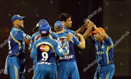 Stock Image of Andrew Symonds, Munaf Patel, Sachin Tendulkar Mumbai Indians Andrew Symonds, left, Munaf Patel, second right and Sachin Tendulkar, right, celebrate Pune Warriors batsman Graeme Smith's wicket during the Indian Premier League (IPL) cricket match in Mumbai, India