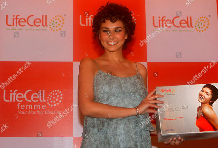 Bollywood actress and model Lisa Ray smiles during the launch of LifeCell Femme Menstrual blood banking service in Mumbai, India, . LifeCell is the first and only company offering menstrual blood banking to harvest stem cells in India