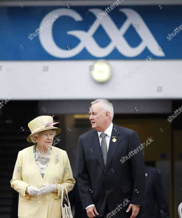 Britain's Queen Elizabeth II and Christy Cooney, President of the Gaelic Athletic Association, look out at the pitch at the home of the GAA, Croke Park Stadium, in Dublin, site of a notorious massacre where British troops killed 14 Irish civilians in 1920. The Queen's visit to Croke Park on the second day of her historic trip to the Republic of Ireland highlights the vast improvement in Anglo-Irish relations since those dark days. It brought the English monarch to a large sports stadium that is a revered spot for Irish nationalists who mourn those who died there during the conflict with Britain