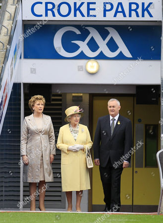 Britain's Queen Elizabeth II, centre, Irish President Mary Mc Aleese, left and Christy Cooney, President of the Gaelic Athletic Association look out at the pitch at the home of the GAA, Croke Park Stadium, in Dublin, site of a notorious massacre where British troops killed 14 Irish civilians in 1920. The Queen's visit to Croke Park on the second day of her historic trip to the Republic of Ireland highlights the vast improvement in Anglo-Irish relations since those dark days. It brought the English monarch to a large sports stadium that is a revered spot for Irish nationalists who mourn those who died there during the conflict with Britain
