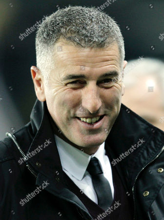 Mauro Tassotti In this March 5, 2011 photo, former AC Milan player Mauro Tassotti smiles during a Serie A soccer match between Juventus and AC Milan at the Olympic stadium in Turin, Italy. AC Milan announced on its website that it fired coach Massimiliano Allegri and put assistant Mauro Tassotti temporarily in charge following AS Milan's embarassing 4-3 loss to Sassuolo on Sunday, Jan.12