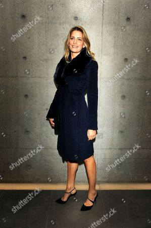 Stock Image of Tatiana Blatnik, wife of the second son of King Constantine and Queen Anne-Marie, Prince Nikolaos of Greece and Denmark, poses prior to attending the Giorgio Armani Fall/Winter 2011 collection presented in Milan, Italy