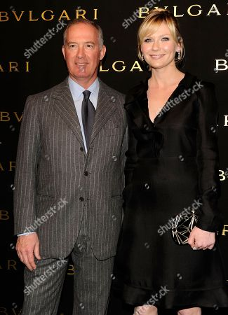US Actress Kirsten Dunst poses with Francesco Trapani (CEO Bulgari) at the media presentation of the Mon Jasmin Noir, (Bulgari's forthcoming fragrance for women) in Milan, Italy, on Friday, Feb 25, 2011