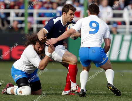France's Aurelien Rougerie, center, is tackled by Italy's Martin Castrogiovanni, left, and Fabio Semenzato during a six nations international rugby union match between Italy and France, in Rome