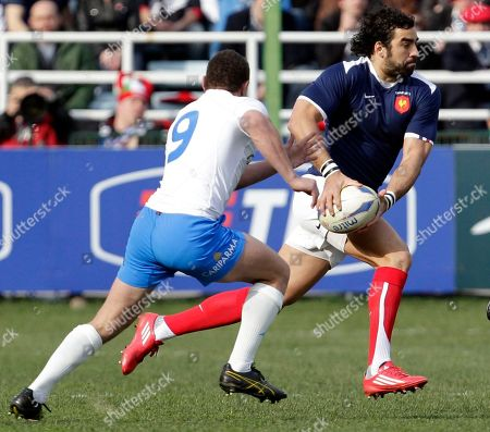 France's Yoann Huget, right, is tackled by Italy's Fabio Semenzato during a six nations international rugby union match between Italy and France, in Rome