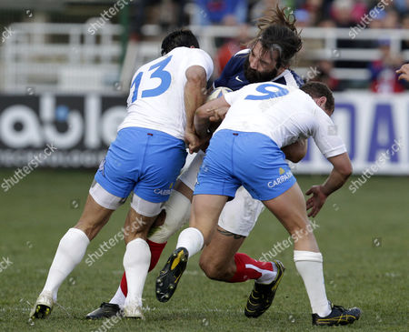 France's Sebastien Chabal, center, is tackled by Italy's Gonzalo Canale, left, and Fabio Semenzato during a six nations international rugby union match between Italy and France, in Rome