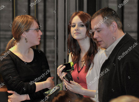 Amanda Knox's college friend Madison Paxton from Utah, left, stands with Amanda's stepfather Chris Mellas, right, and Deanna Knox, Amanda's younger sister, during a hearing in the Amanda Knox's appeals trial, at Perugia's courthouse, Italy, . Knox was convicted of murdering her British roommate in Perugia, Meredith Kercher, and sentenced to 26 years in prison. Her co-defendant and ex-boyfriend Raffaele Sollecito was also convicted and sentenced to 25 years. They both deny wrongdoing and have appealed the 2009 verdict