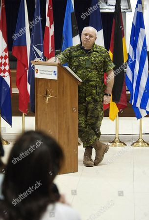 """Charles Bouchard The new NATO commander of the international military operation in Libya, Canadian Lt. Gen. Charles Bouchard meets journalists at NATO headquarters, in Bagnoli, Naples, Italy, . The new commander of international military operations in Libya warned Thursday that anyone attacking civilians would be """"ill-advised"""" to continue, and said he would look into a report by a Vatican envoy that air strikes had killed 40 innocent people"""