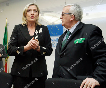 Marine Le Pen, the daughter of France's longtime far-right leader who now heads his National Front party, left, talks with Italian Northern League member of the EU Parliament Mario Borghezio prior to the start of a press conference, in Rome, . Le Pen is in Rome the day after touring a center for illegal migrants on Italy's southernmost island of Lampedusa, Monday, March 14, 2011. Despite her party's anti-immigrant politics, Le Pen insisted before her arrival that the visit is aimed at gathering information, not at provocation. Le Pen, 42, who is stumping for next year's French presidential race, has been trying to soften the National Front's xenophobic image