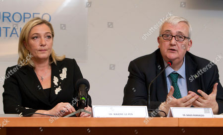 Marine Le Pen, the daughter of France's longtime far-right leader who now heads his National Front party, left, listens as Italian Northern League member of the EU Parliament Mario Borghezio talks during a press conference, in Rome, . Le Pen is in Rome the day after touring a center for illegal migrants on Italy's southernmost island of Lampedusa. Despite her party's anti-immigrant politics, Le Pen insisted before her arrival that the visit is aimed at gathering information, not at provocation. Le Pen, 42, who is stumping for next year's French presidential race, has been trying to soften the National Front's xenophobic image