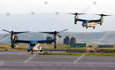 Two MV-22 Osprey vertical take off and lift aircrafts land with on board US General Carter Ham, Commander of the United States Africa Command, in the Sigonella airbase, Sicily